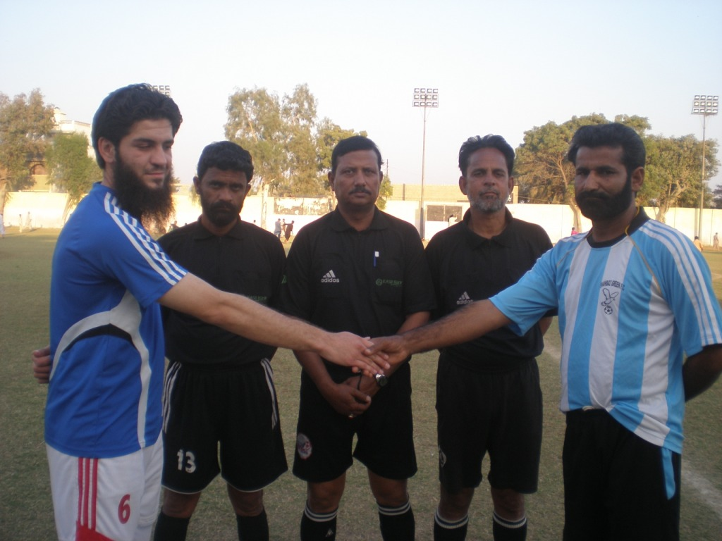 Captains of Shabaz Green and FC Rovers shake hand before match
