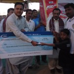 Noman Abdullah Murad presenting checque of Rs.100,000 to late Hussain Baloch family