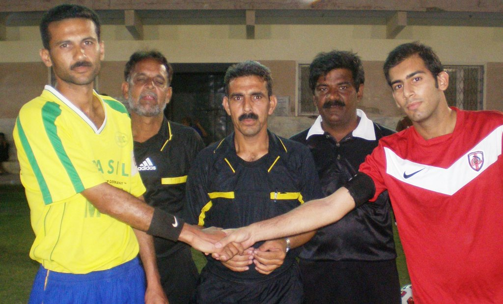 Captains of Irfan Memorial and Karachi United shake hands