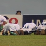 Pakistani players prostrate after Hassan Bashir's 13th minute goal against Nepal.