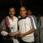 Khalid Ghullo presents shield to Riaz Ahmed for his media coordinator work in Dadu