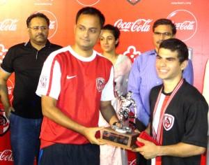 Imran Ali presenting MVP award to Karim Kerai of KUFC