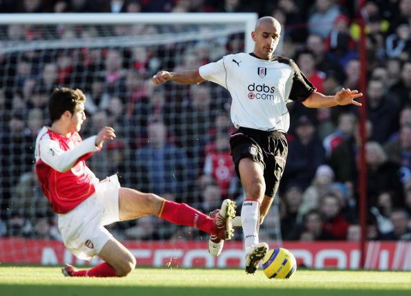 Arsenal's Fabregas tackles Zesh Rehman.