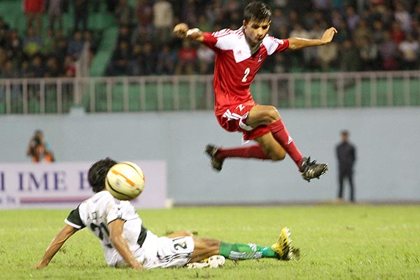 Pakistan's Riaz goes into a deep tackle against his opposing number.