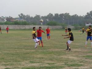 Lions FC (Jhelum) 2-1 Al-Falah FC (Jhelum). Lions in black, Al-Falah in red