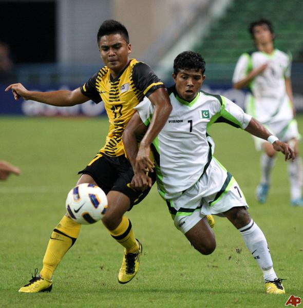 Adil in action for Pakistan.
